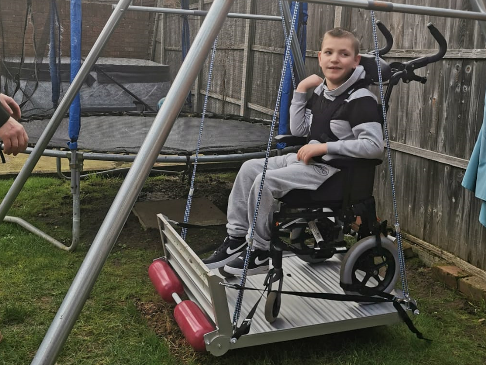 William Enjoys His Wheel Chair Swing